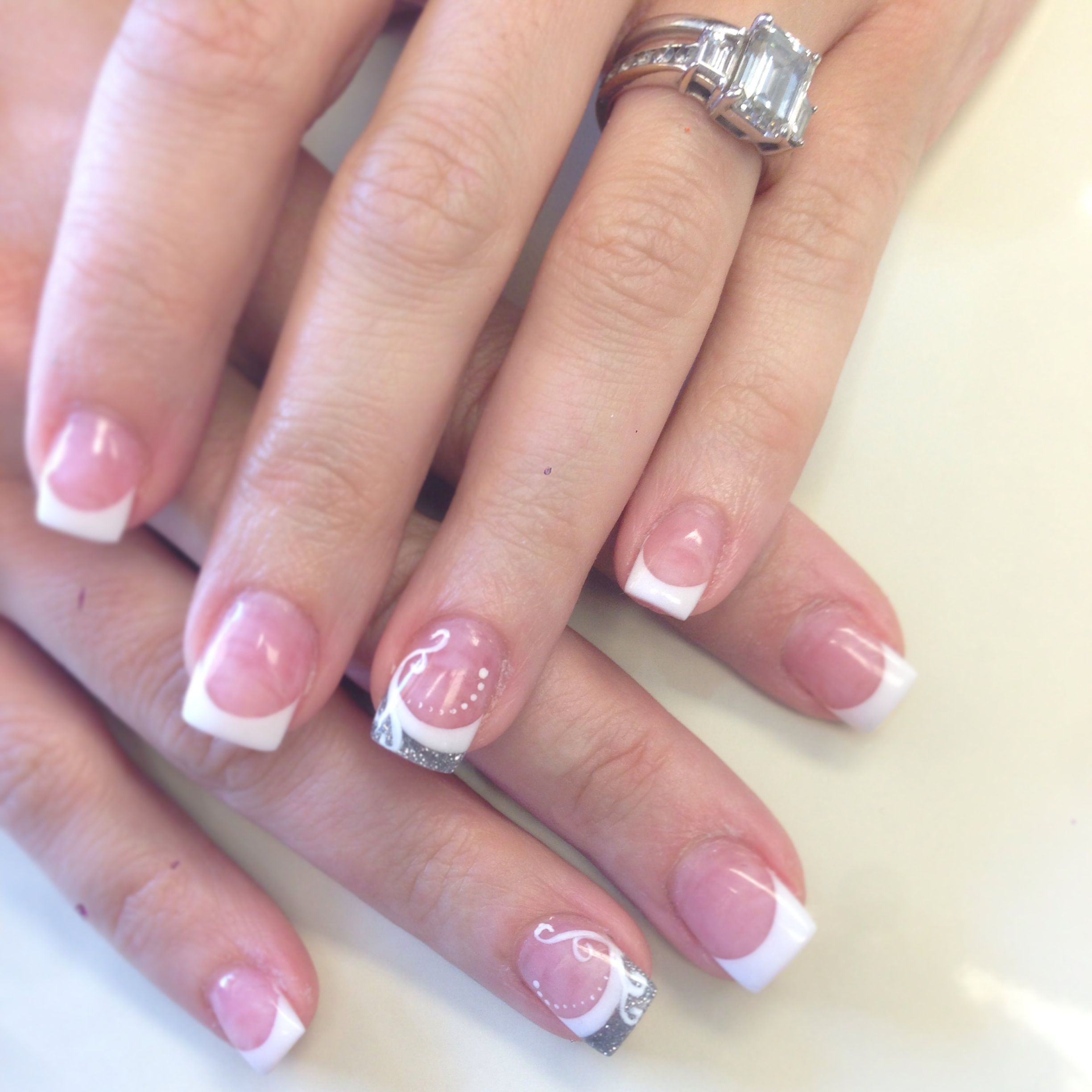 Dainty design on French | Nails by The Haute Spot | Pinterest
