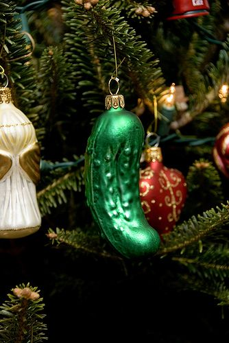 the christmas pickle tradition an old german tradition the blown glass pickle ornament is hidden in the small branches of the christmas tree