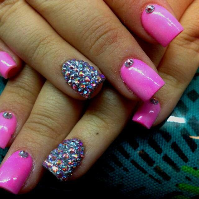 Pink nails with gems at the nail bases on each finger and ring ...
