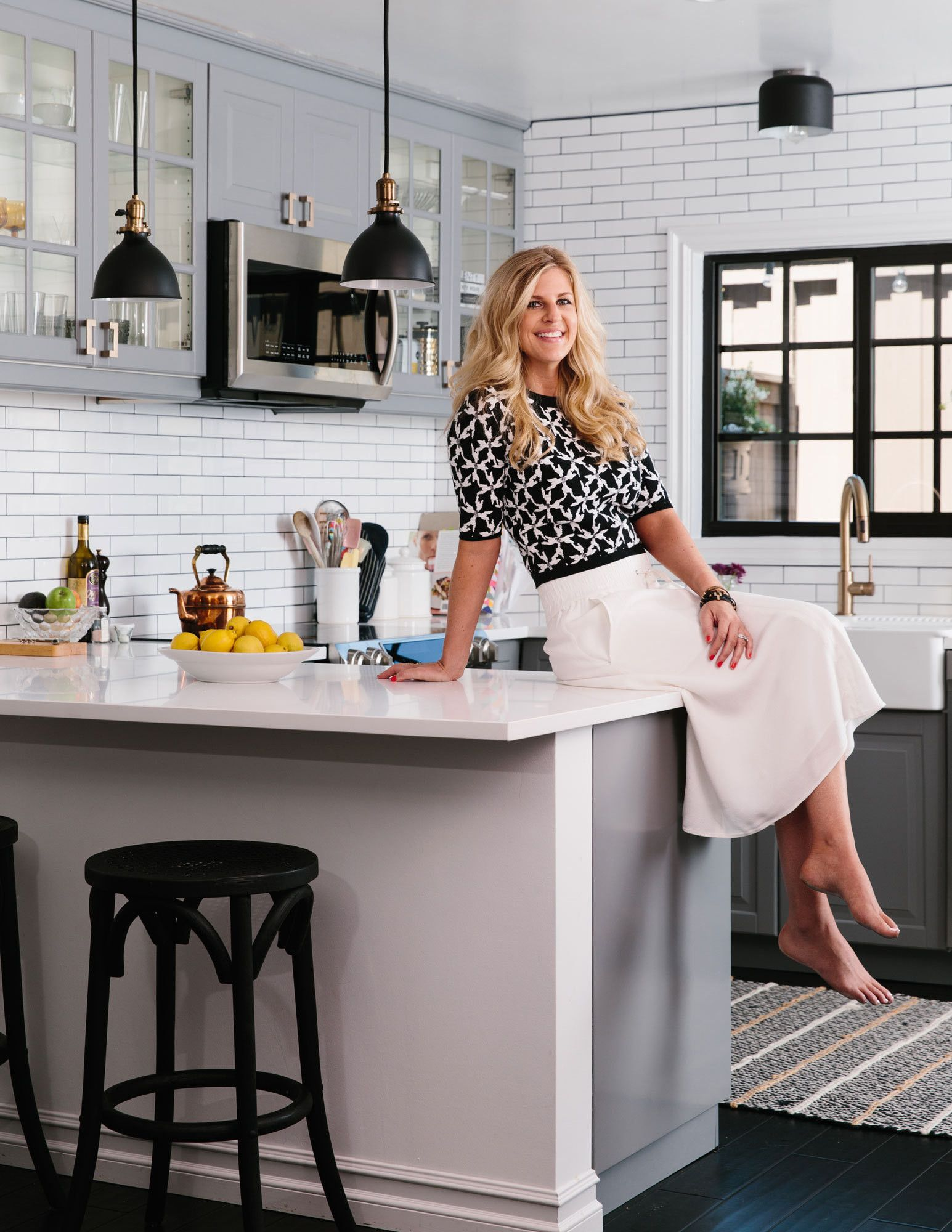 Ten tips from rundown rental to chic starter home matte black schoneveld shows off her customized ikea kitchen which she upgraded with matte black light fixtures arubaitofo Image collections