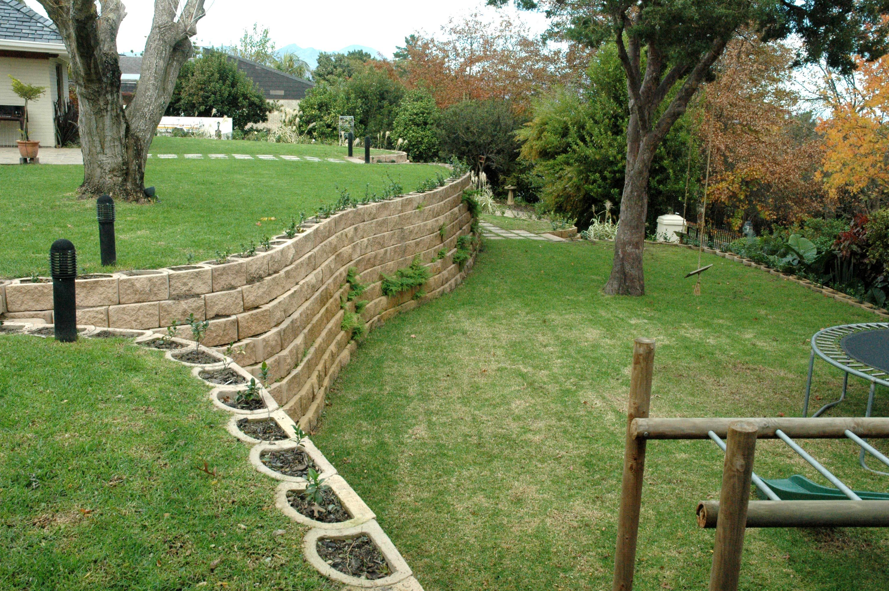 A Steep Garden Transformed with Retaining Wall Blocks  Sloped