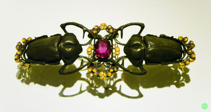 Beetle Corsage Ornament. Rene Lalique (1860 -1945). Circa 1902 -1903. Gold, silver, enamel and tourmaline. 5.2 x 16 cm. Housed at the C...