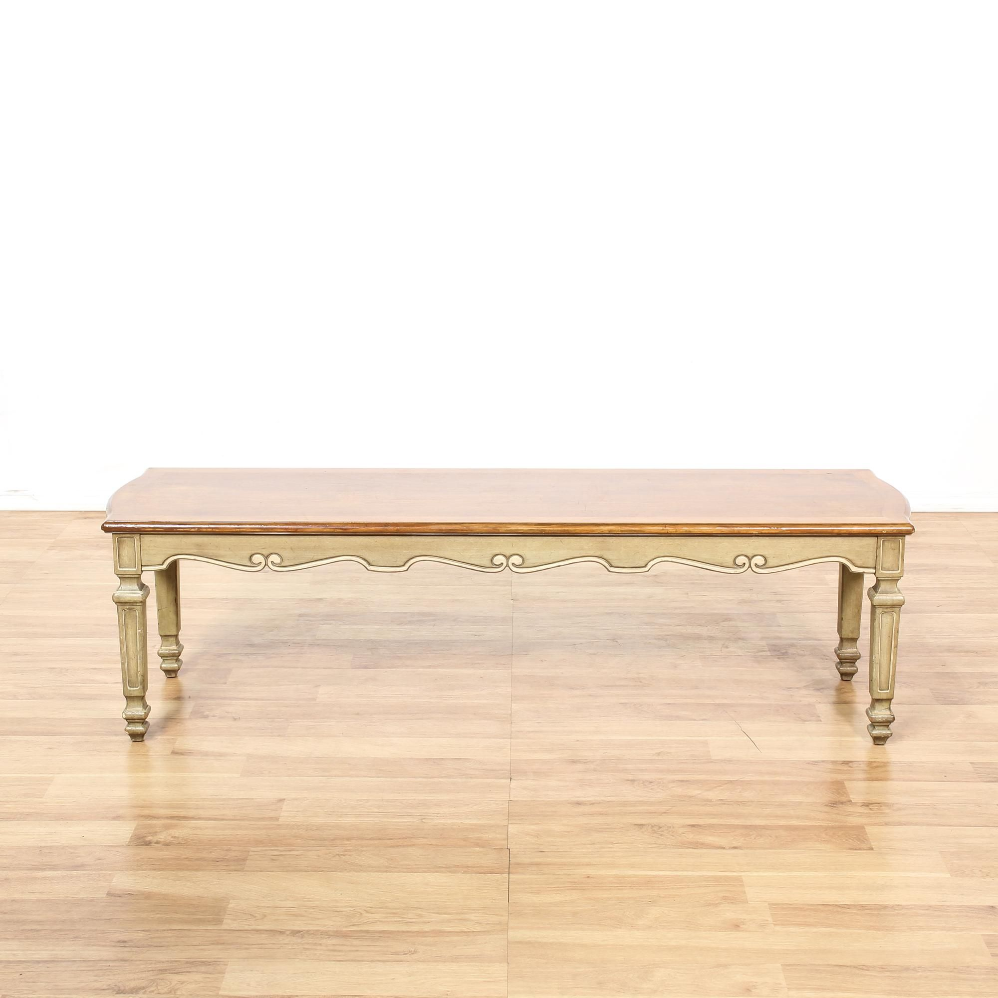 This french provincial coffee table is featured in a solid wood