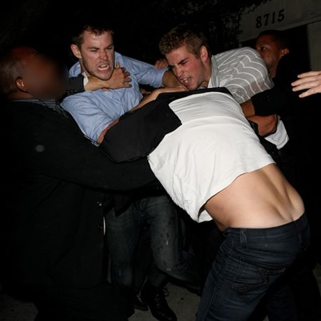 Chris and Liam Hemsworth brawling with some guy outside a bar... Mmm, that's hot.