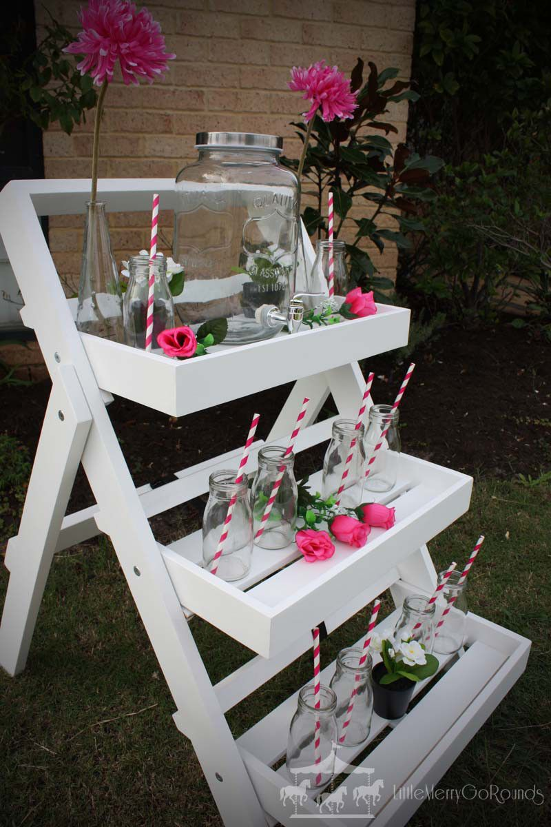 Kids drinks station bar with pink flower decorations hire rent for