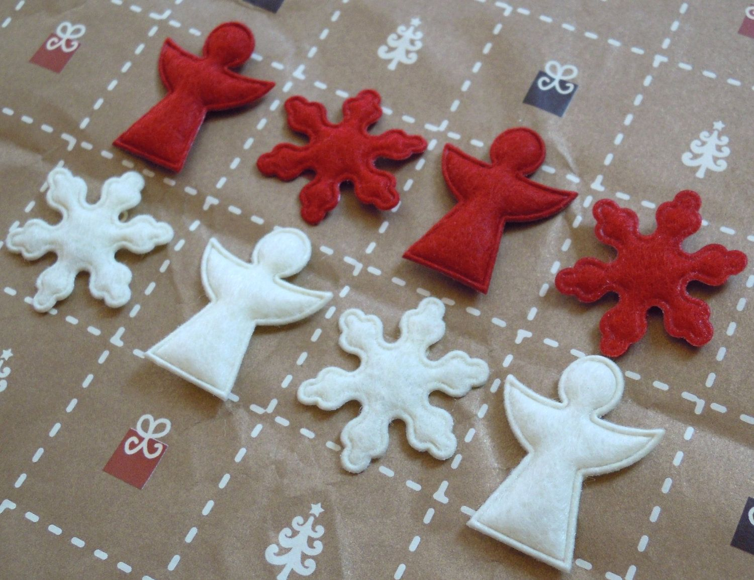 Cute felt angels and snowflakes - holly red and cream - set of 8 pieces. $2.40, via Etsy.