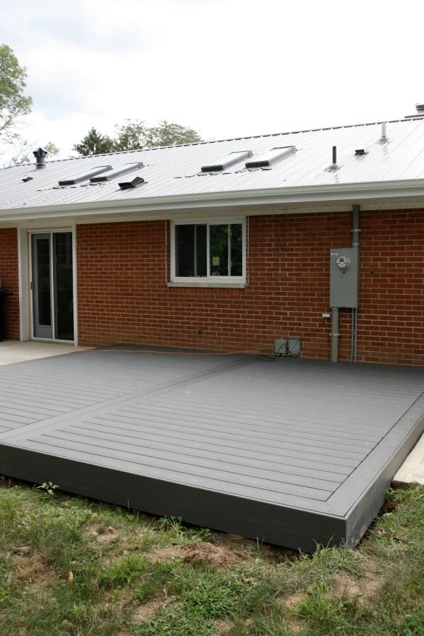 Low profile trex deck via house tweaking on the outside for Low deck designs