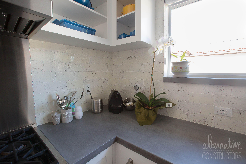 - Grey Concrete Kitchen Countertop And Concrete Backsplash Tiles