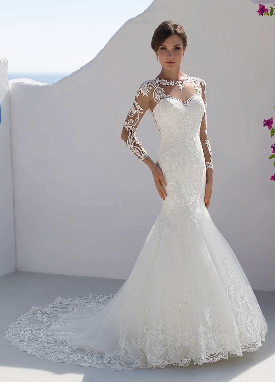 d621f4603ea4 Mark Lesley 7202 Lace sleeved fitted wedding dress.Illusion neckline with  lace covered appliques. Fitted fishtail style.Comes with various train ...