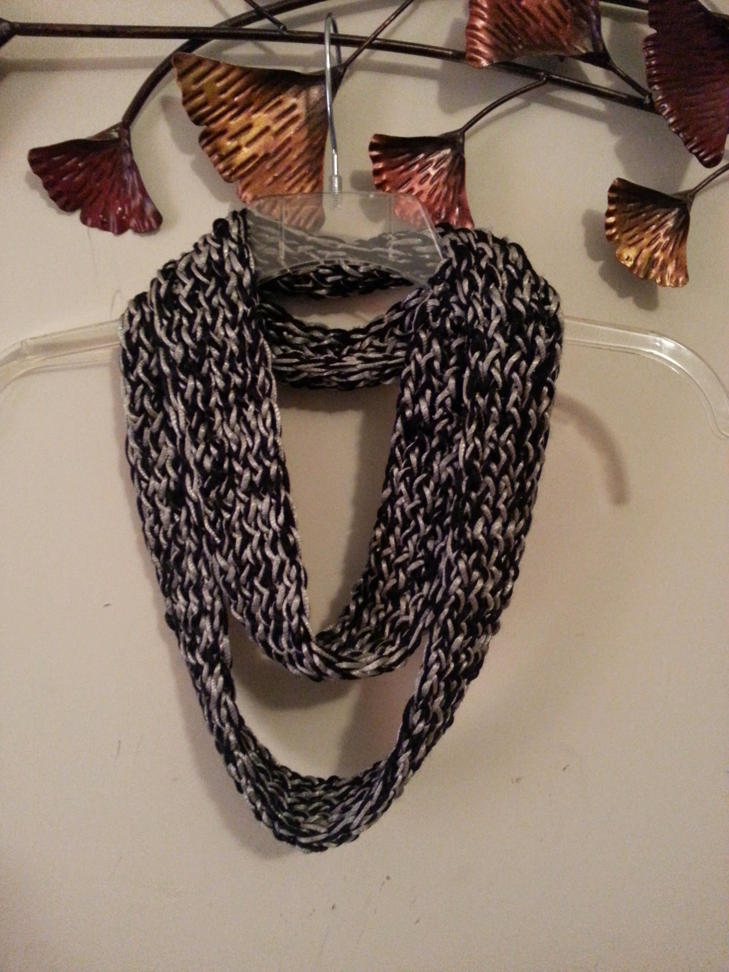 I combined two yarns, black and platinum Patons Metallic, using the ...