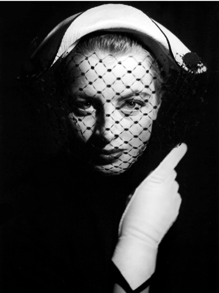 Photo Georges Dambier, April 1952, Capucine in hat by Jean Barthet, Arachnée.