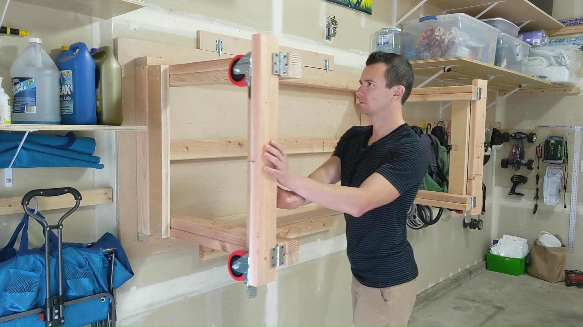My cheap DIY foldable wall mounted workshop table - Unfold demonstration