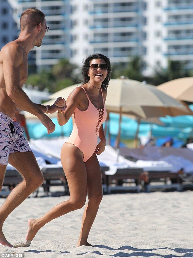 618cfff1ad3 Kourtney puts bodacious behind on show in thong bathing suit in Miami