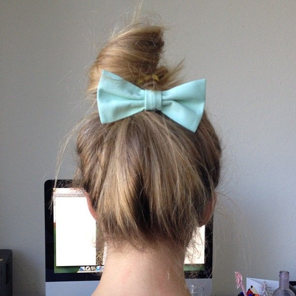 @Caitlin Knoop is sporting our bow tie in her hair. how cute is she?