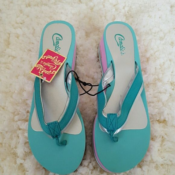 Candies platform flip flops Candies platform flip flops, thong sandal. Comfy and gives you a little lift to show off your calves!  Teal and pink! SZ M, 7-8. Candie's Shoes Sandals