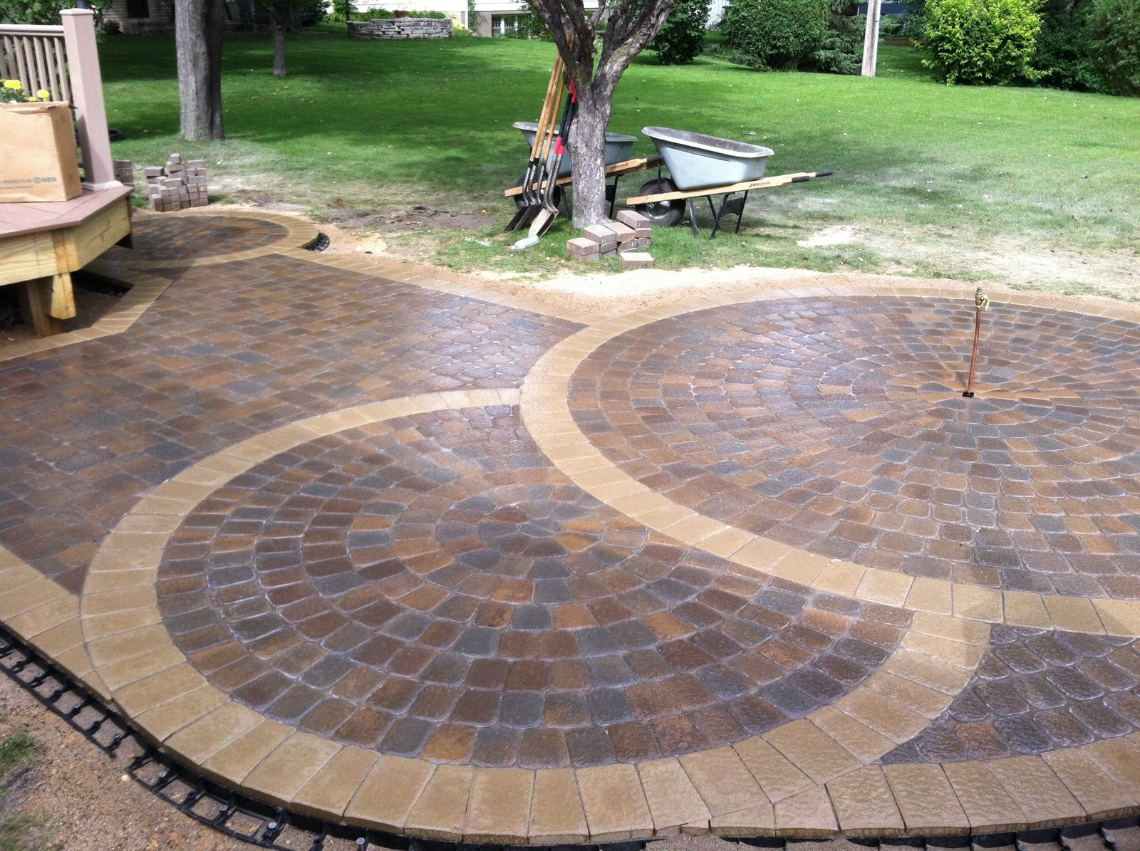 The Nearly Completed Circular #patio. Anchor Kingston #pavers Were Used In  The Center Of The Patio And Buff Limestone Pavers Were Used Around The  Border.