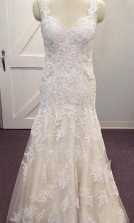 Stella York 6103 10: buy this dress for a fraction of the salon price on PreOwnedWeddingDresses.com