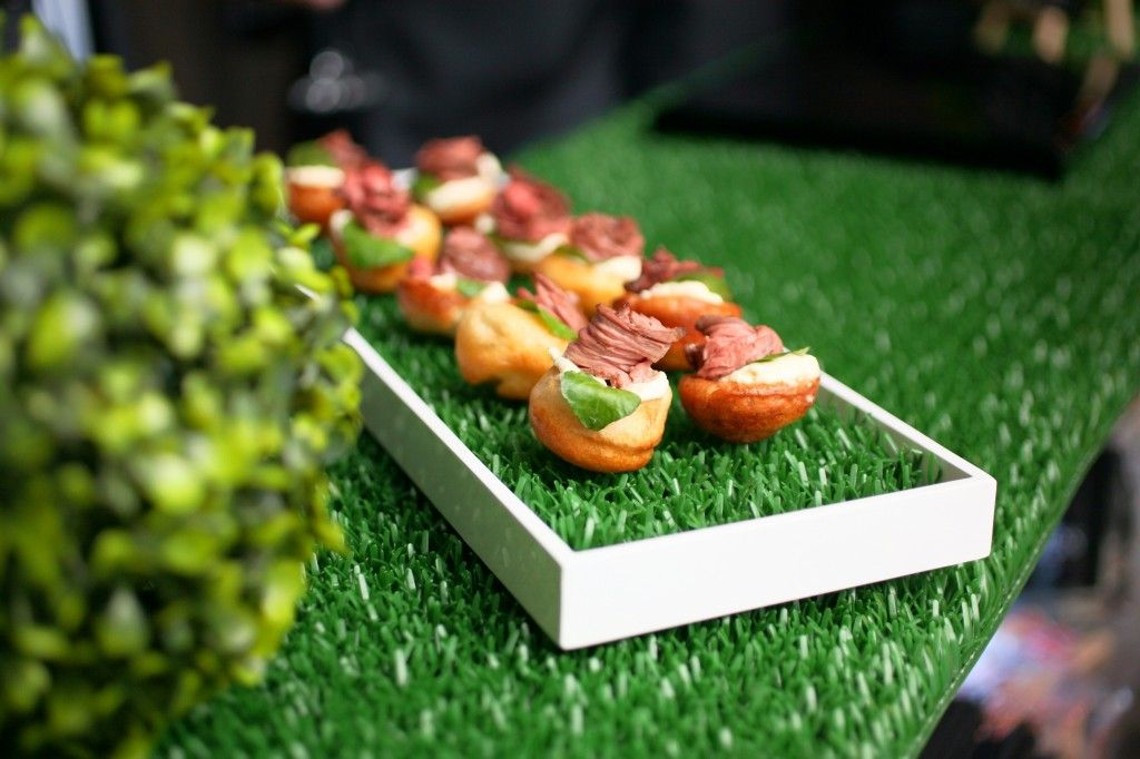 Indoor picnic mini yorkshire puddings served on grassed for Canape serving platters