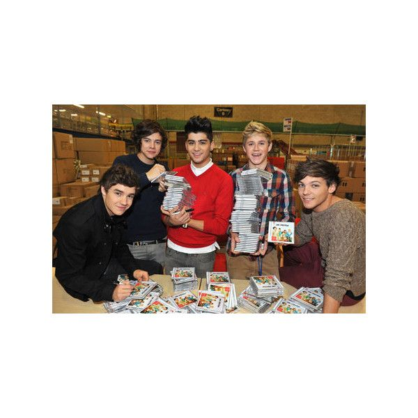 One Direction get wrapped up in Christmas! Getting into shenanigans at the Amazon UK warehouse for the release of their Up All Night album. Photos - Yahoo!7 Lifestyle found on Polyvore featuring one direction