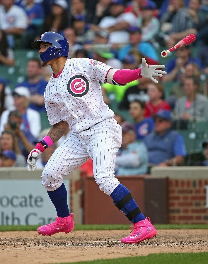 Javier Baez #9 of the Chicago Cubs follows the flight of his game-winning, walk off home run against the Washington Nationals at Wrigley Field on May 8, 2016 in Chicago, Illinois. The Cubs defeated the Nationals 4-3 in 13 innings.