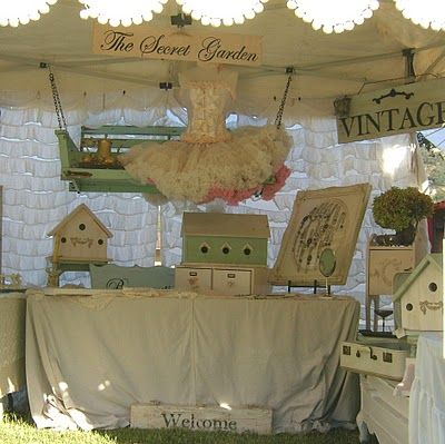 hang shelf from tent support  Chateau De Fleurs: A Few Fun And Fabulous booth Presentations From the September 2011 TVM