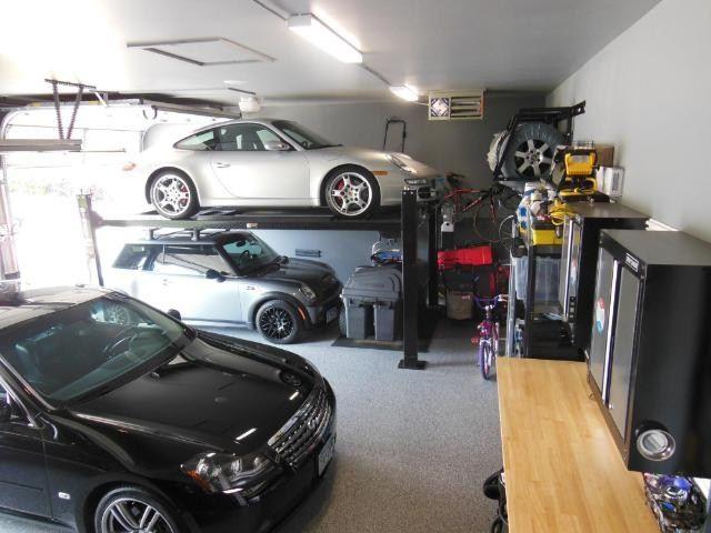 Hydraulic Car Lift Allows For Storage Of Four Cars In A Three Stall Garage Garage Autos Aufzug