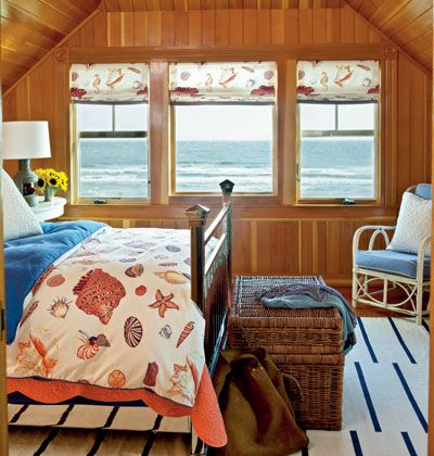 Cozy colorful coastal bedroom in blue and orange Cottage by the
