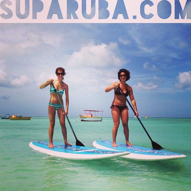 Sisters like to paddleboard at Stand Up Paddle Aruba!