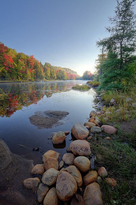 A misty morning on Bald Mountain Pond in Old Forge, New York