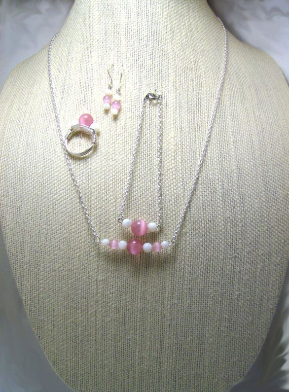 Pink Cats eye Pearls, White Shell Beads combined to make Earrings, Bracelet, Necklace, and Ring set.