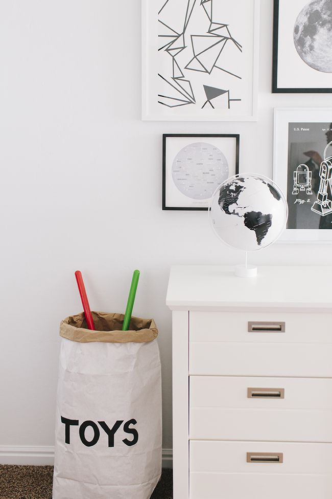 With walls painted in Extra White SW 7006 and simplistic, modern black and white decor, this kids room is super sophisticated.
