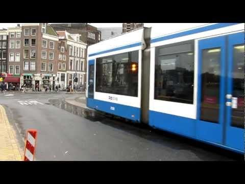 Trams in rainy Amsterdam