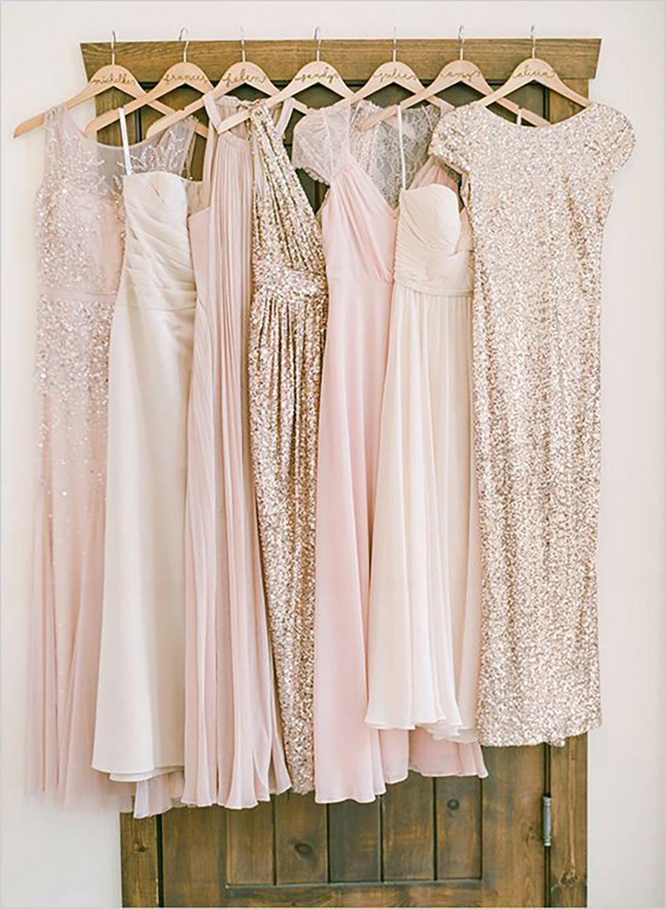 Pink Rose Gold And Bridesmaids Dresses Hung Up On Display