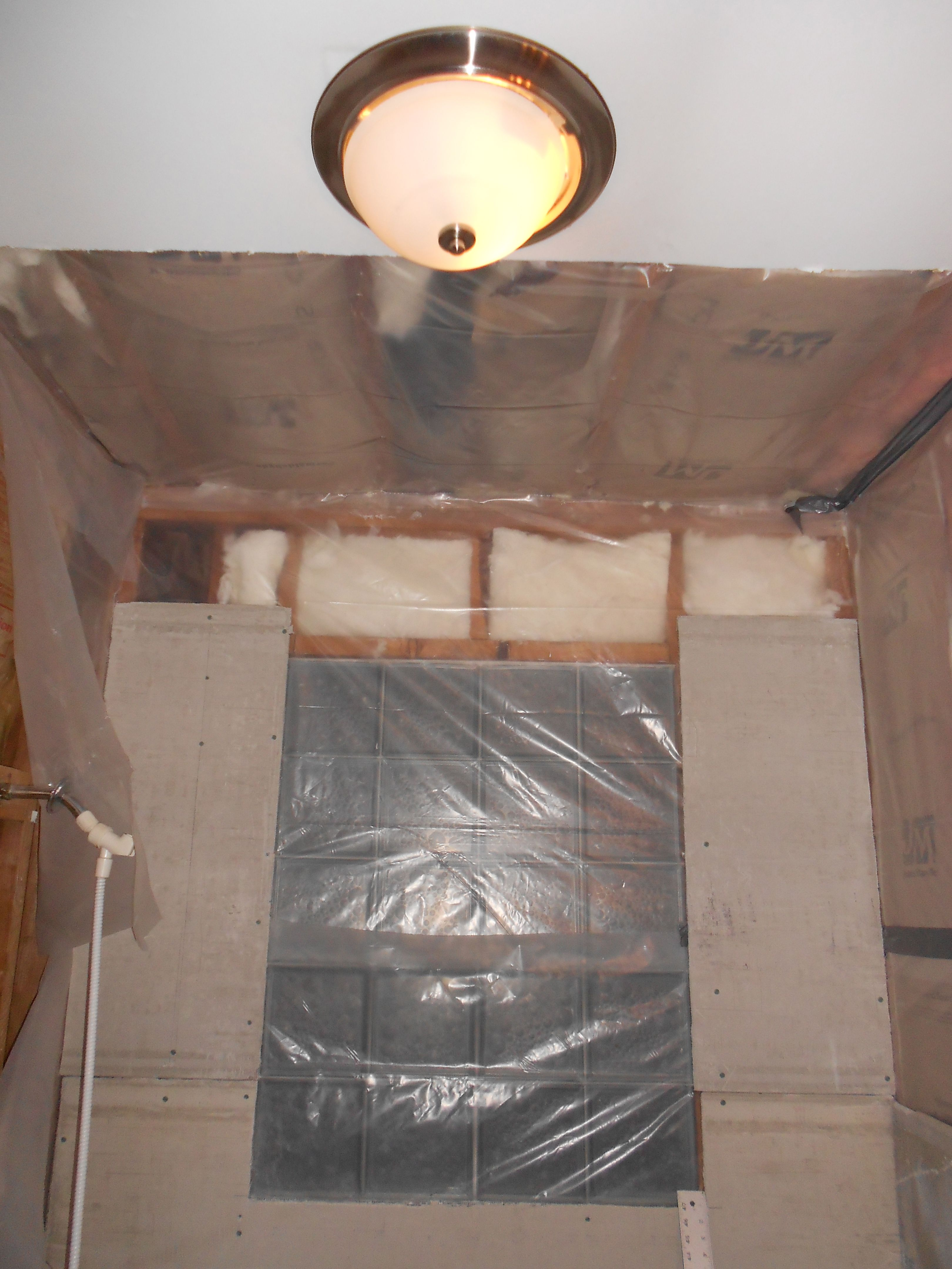 Vapor barrier up and some cement board after gutting all above and ...