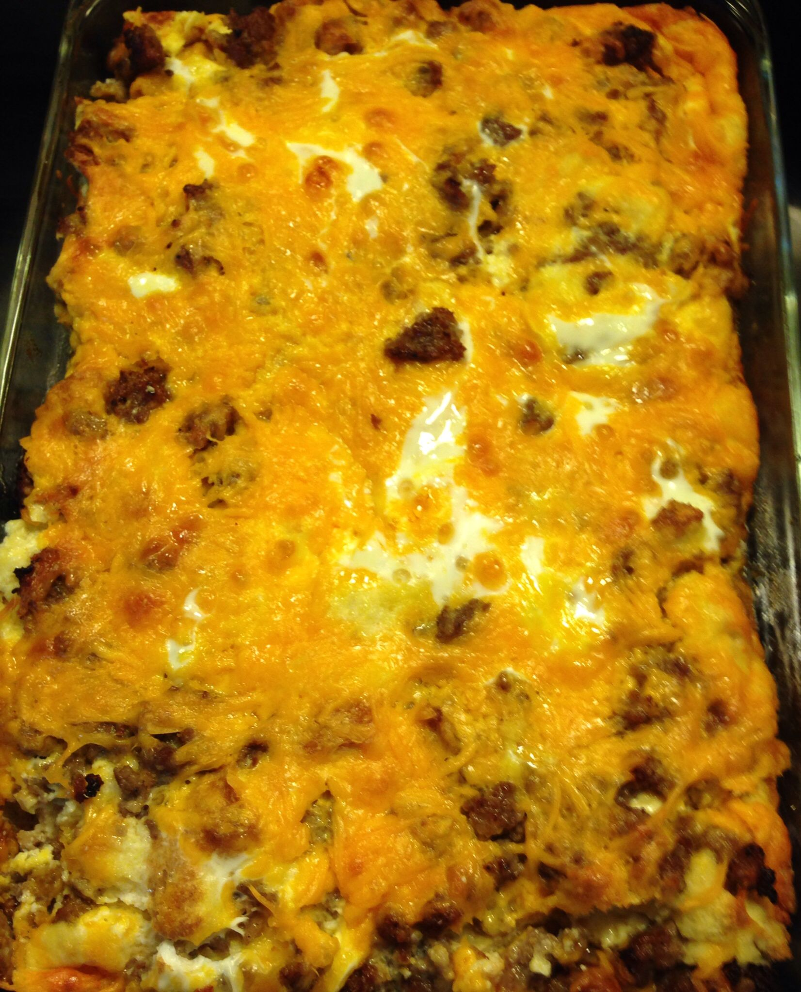 Breakfast Casserole Of Bread On Bottom Of Jimmy Dean Sausage Cooked And Drained Put On Top Of Bread Top With 2 Cups Cheese Mix And 2 Cups Milk Pour On
