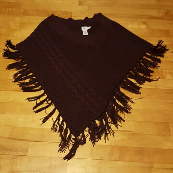 Calvin Klein Poncho Like new thick knitted poncho. Cable stitch on the side and tassels on the bottom. Calvin Klein Sweaters V-Necks