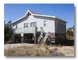 Spruill NAN-05 is a comfortable cottage that is beach appropriate.  A big open kitchen that was updated in '12 looks out over the dining space and ...