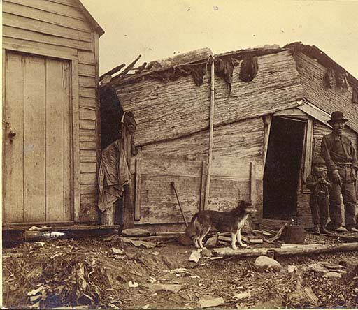 Alaskan house with bark front, possibly Athapascan, Alaska, ca. 1904 :: American Indians of the Pacific Northwest -- Image Portion