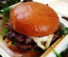 Cholesterol busting burger by The Frenchie - Succulent duck confit with melted cheese in a toasted brioche bun.