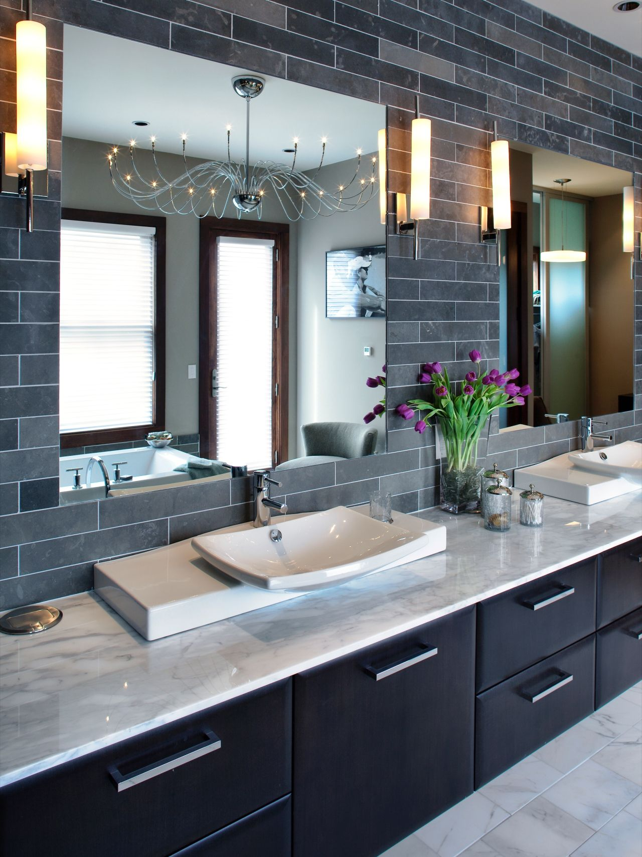 The Gray Tiled Double Vanity In This Contemporary Bathroom Features Two Mirrors Two Sinks Four W Modern Master Bathroom Bathroom Color Schemes Bathroom Color