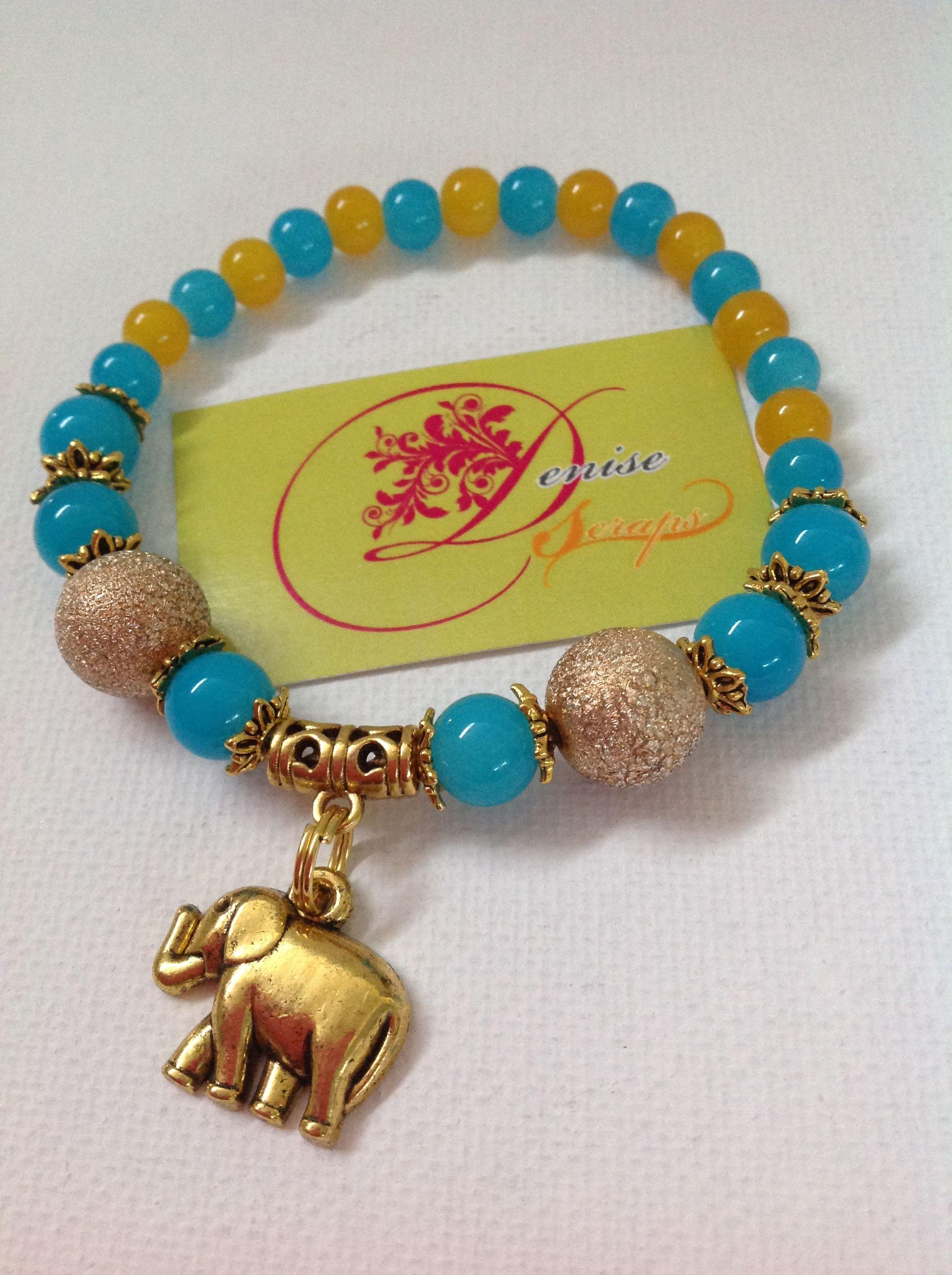 326ef4f25816 photo (123) pulsera en bolitas azules y doradas con elefante dorado ...