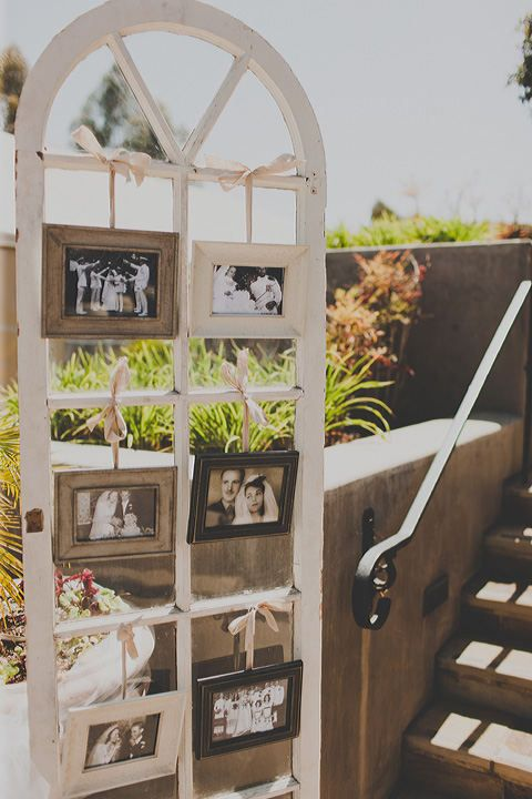 Old window frame with family wedding pictures