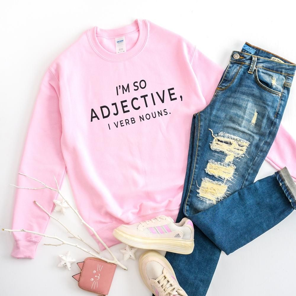 """This """"I'm so adjective, I verb nouns"""" funny grammar saying is printed on Gildan 18000 Unisex Pullover Sweatshirt using eco-friendly fabric ink. A sturdy and warm sweatshirt bound to keep you warm in the colder months. A pre-shrunk, classic fit sweater that's made with air-jet spun yarn for a soft feel and reduced pilling. • 50% cotton, 50% polyester • Pre-shrunk • Classic fit • 1x1 athletic rib knit collar with spandex • Air-jet spun yarn with a soft feel and reduced pilling • Double-needle stit"""