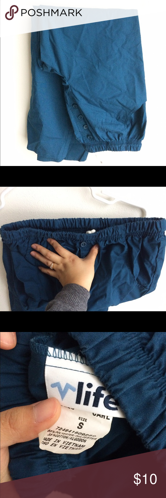 Caribbean blue scrub pant. Very comfy scrub pant. Stretchy waist band with extra string to pull. Buttons in front. Hip pockets. Petite. life uniform Pants