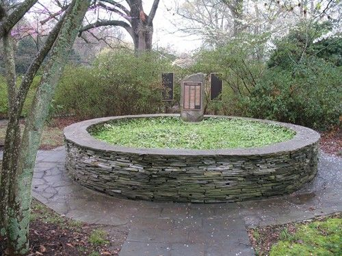 I like the circular raised stone bed for the garden for Circular raised garden bed ideas