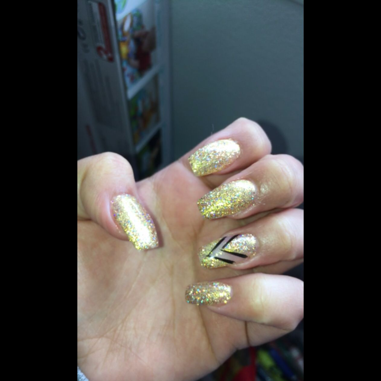 Acrylic nail fill. I got a sparkle gold gel polish with an accent ...