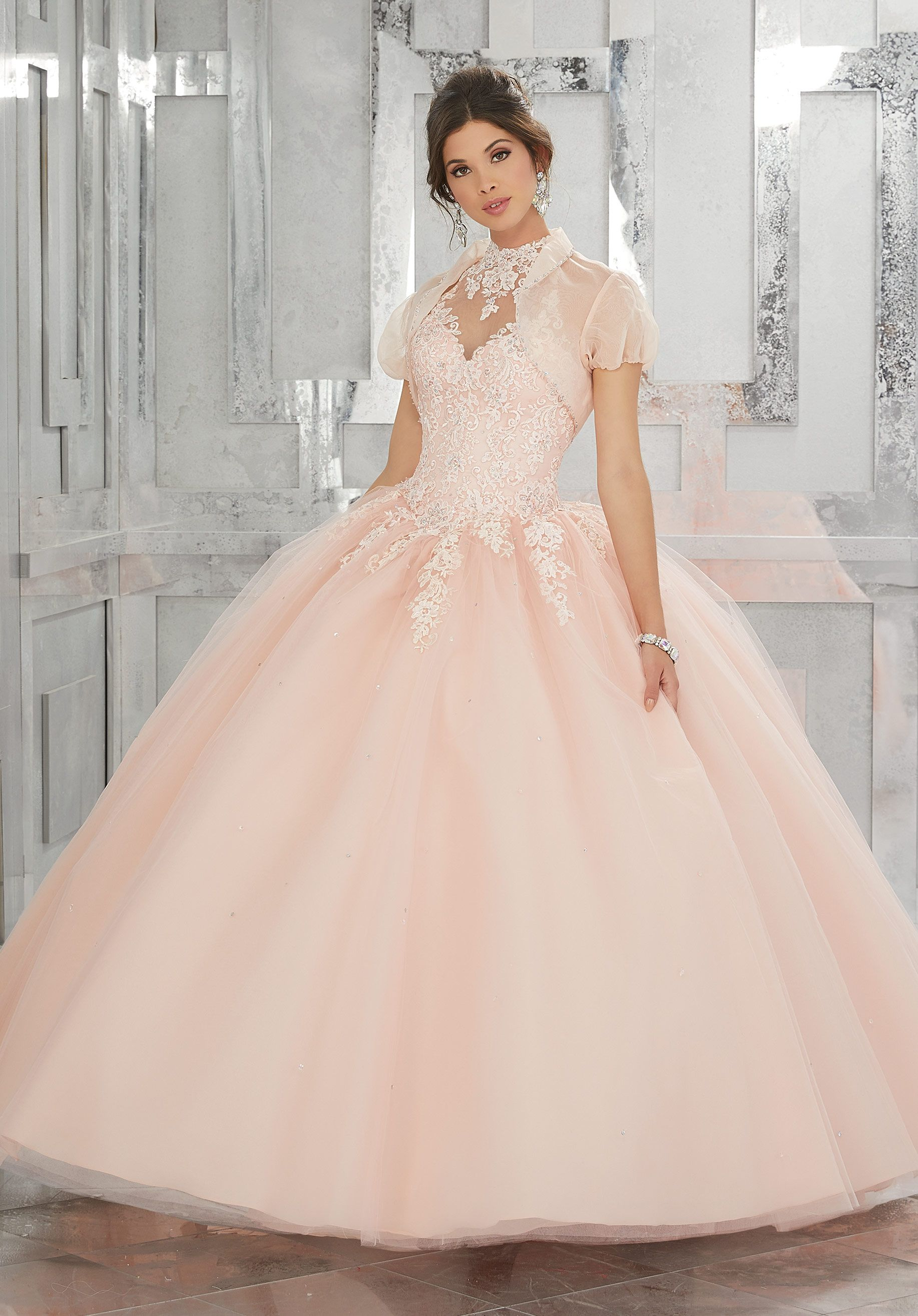 A Full Tulle Skirt And Keyhole Corset Back Complete The Look Matching Bolero Jacket Included Colors Available Blush