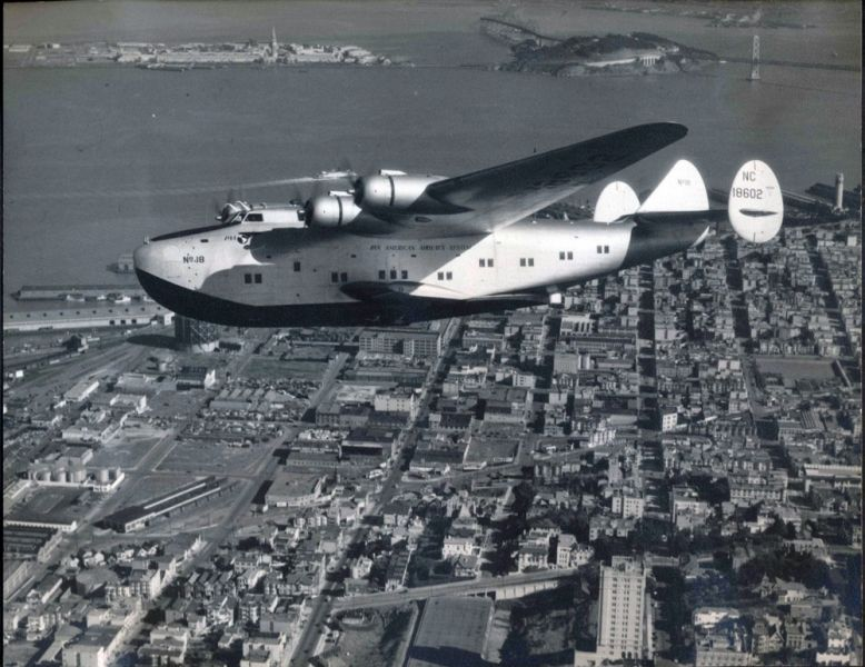 Pan American Airways Boeing B314 'California Clipper' NC18602, over San Francisco with the recently completed Bay Bridge in the background. Circa 1939.