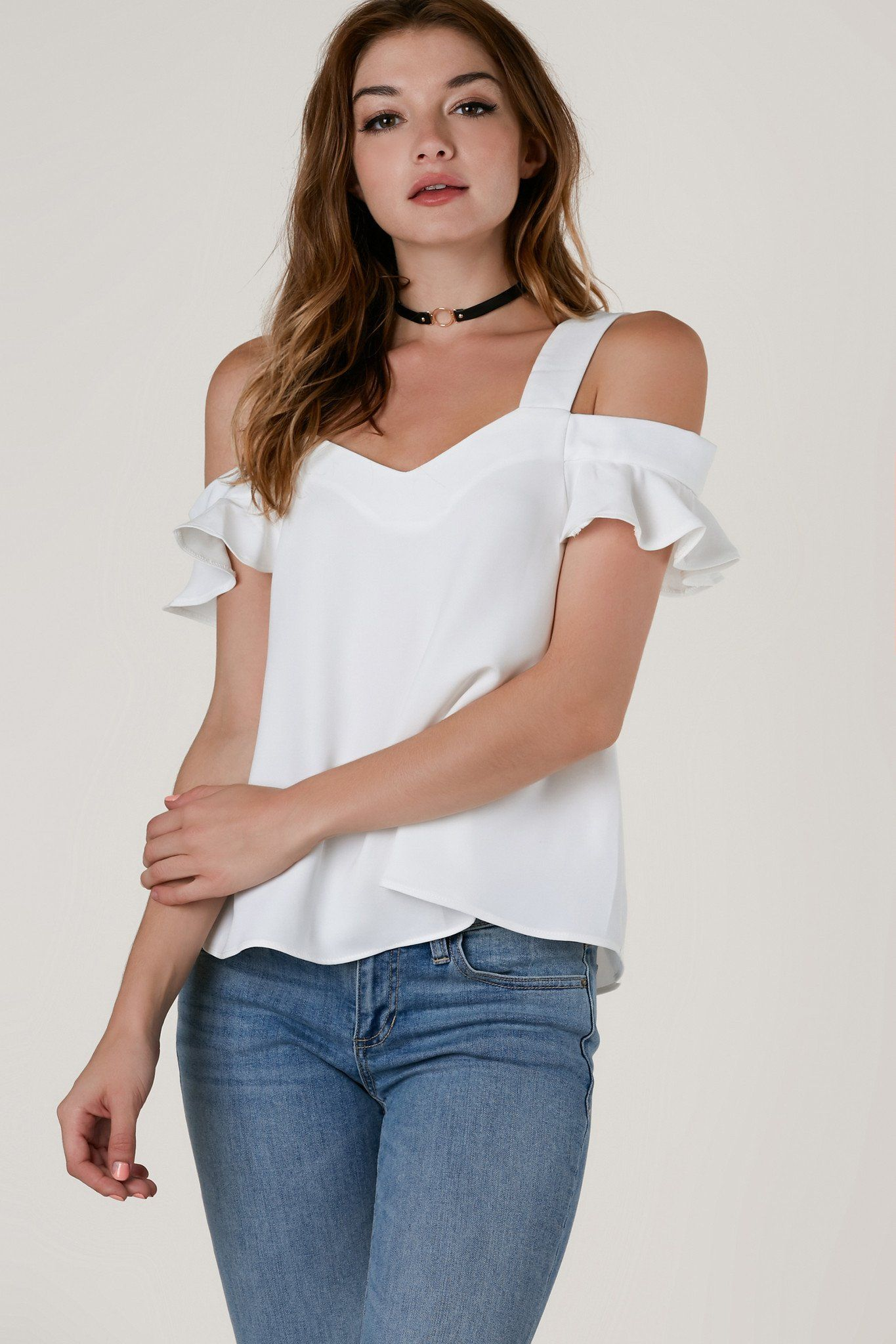 6776db251f4e4 Flirty cold shoulder top with ruffle trim detailing on sleeves. Oversized  fit with soft V-neckline and A-line hem.