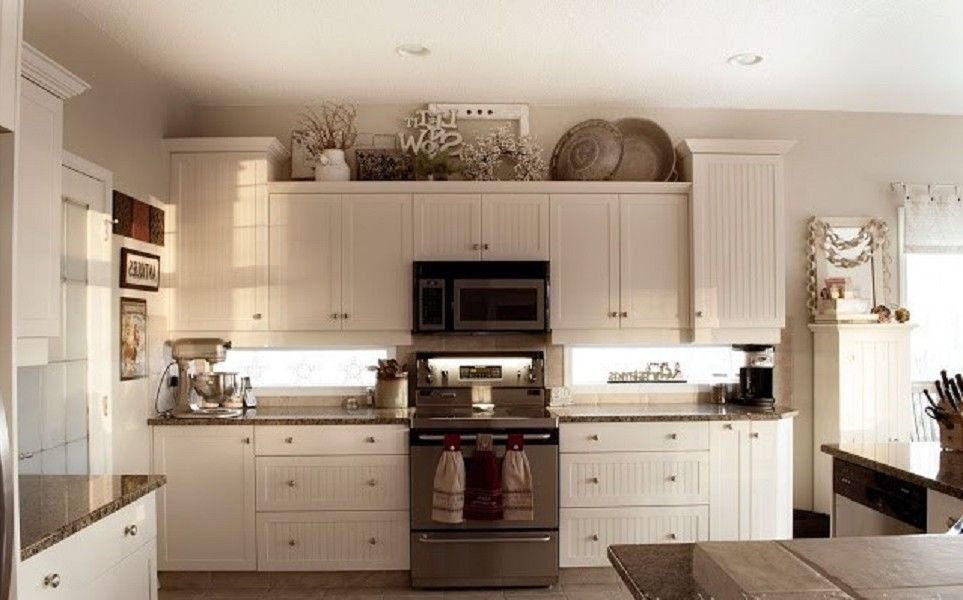 Above Kitchen Cabinet Decor Classic White Wooden Wall